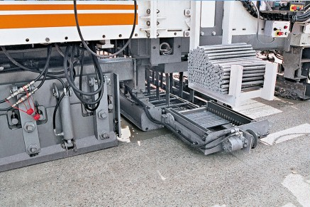 Automatically inserted dowel bars transfer loads from one concrete slab to another