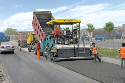 VÖGELE pavers laying a new surface course.