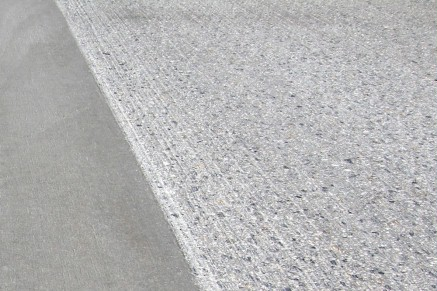 The surface accuracy and grip of the roadway are restored in this way.