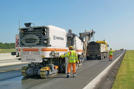A WIRTGEN cold milling machine roughening the runway at Cambridge Airport, UK.