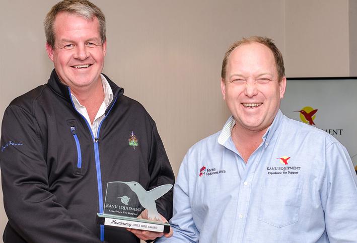 David Alcock accepts his Honorary Little Bird Award trophy